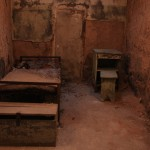 "A typical cell with bed, night stand and chest. One pressing problem for early prison administrators was curbing masturbation, known then as ""the solitary vice."""