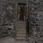 This door leads to a watchtower stairwell. The perimeter wall is 30-feet high, 12-feet thick, and was built with rounded corners so inmates couldn't shimmy up.